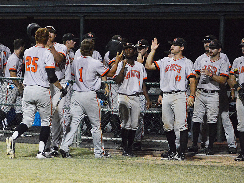 Sam Houston State's Jordan Cannon (25) and Mac Odom (1) are congratulated by teammates after scoring in the top of the ninth inning to tie it 4-4 against Incarnate Word on Thursday night. - photo by Joe Alexander