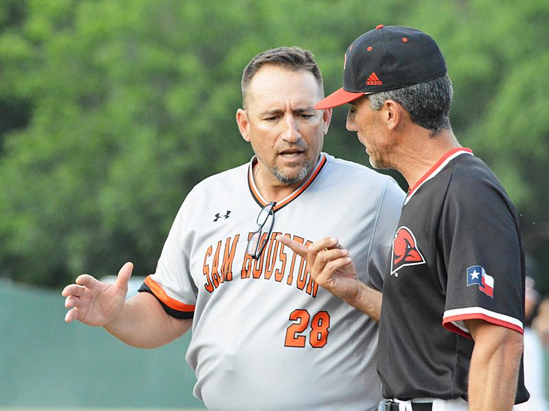 Incarnate Word head baseball coach Patrick Hallmark (right) talks things over with Sam Houston State coach Matt Deggs during Thursday night's game. - photo by Joe Alexander