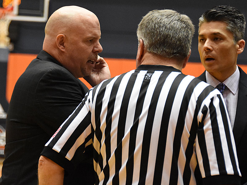 Steve Henson speaks with a referee on the sideline last weekend during a game against Southeastern Oklahoma. - Photo by Joe Alexander