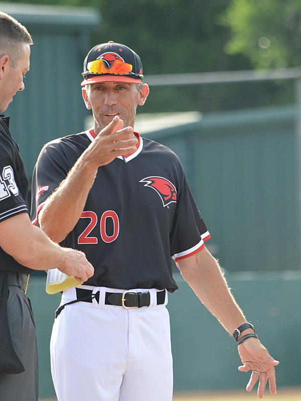 Incarnate Word baseball coach Patrick Hallmark talks to the umpire before Thursday's game against Sam Houston State. - photo by Joe Alexander