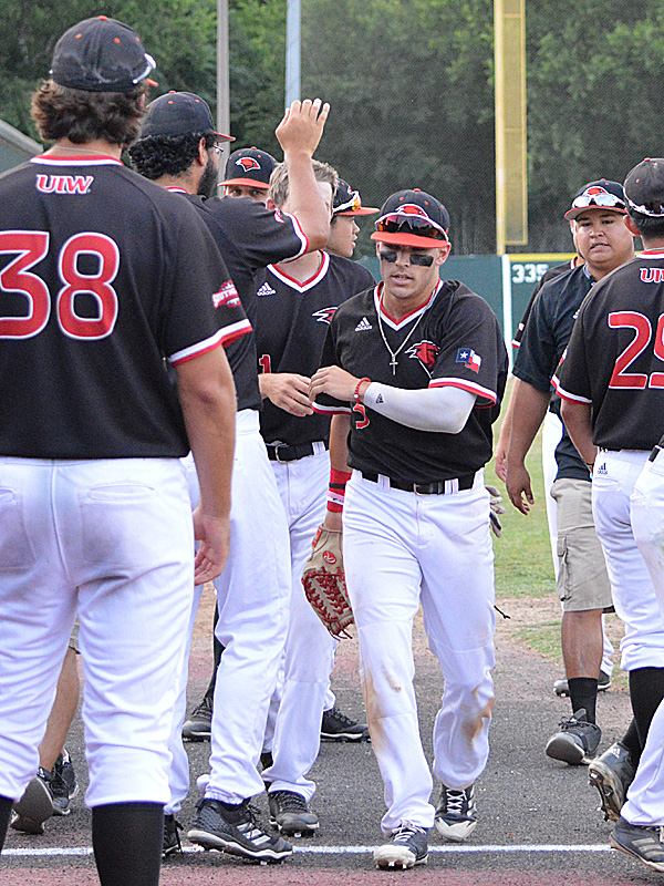 Incarnate Word outfielder Ridge Rivers is congratulated by teammates after making a catch against the wall against Sam Houston State. - photo by Joe Alexander
