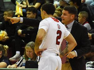 Incarnate Word coach Carson Cunningham gives directions to freshman guard Jordan Caruso in a 90-64 loss to Northern Colorado on Wednesday, Nov. 21, 2018.