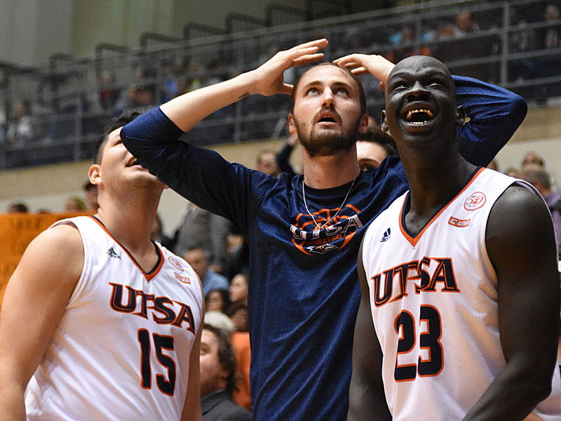 UTSA players on the bench watch the replay of teammate Keaton Wallace's second-half slam dunk on Thursday at the Convocation Center. - photo by Joe Alexander