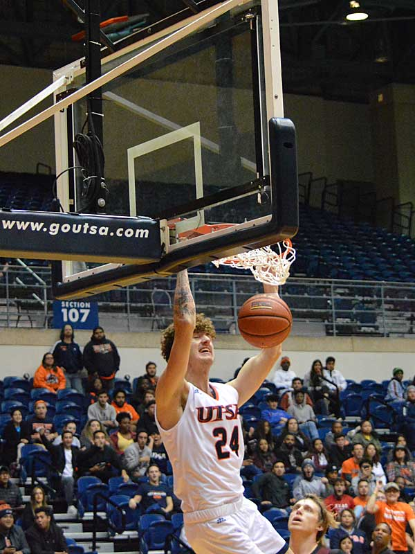 UTSA freshman Jacob Germany throws down a dunk on Wednesday, Oct. 30. 2019 at the UTSA Convocation Center. The Roadrunners beat Texas A&M International 89-60 in an exhibition game. - photo by Joe Alexander