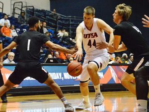UTSA forward Luka Barisic charges through traffic on the dribble in an exhibition against Texas A&M International. - photo by Joe Alexander