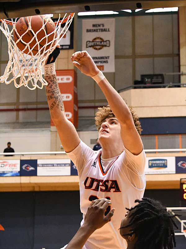 UTSA freshman center Jacob Germany throws down a dunk as UTSA beat Southern Miss 80-70 on Saturday for the Roadrunners' second straight Conference USA victory at the UTSA Convocation Center. - photo by Joe Alexander