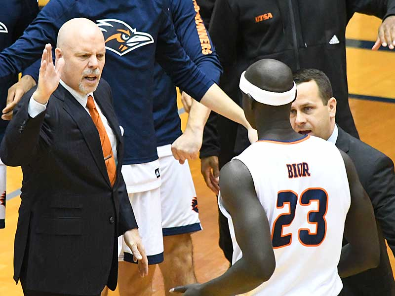 UTSA coach Steve Henson offers encouragement to sophomore forward Atem Bior, who scored a career-high 13 points. UTSA beat UTEP 86-70 on Saturday at the UTSA Convocation Center. - photo by Joe Alexander