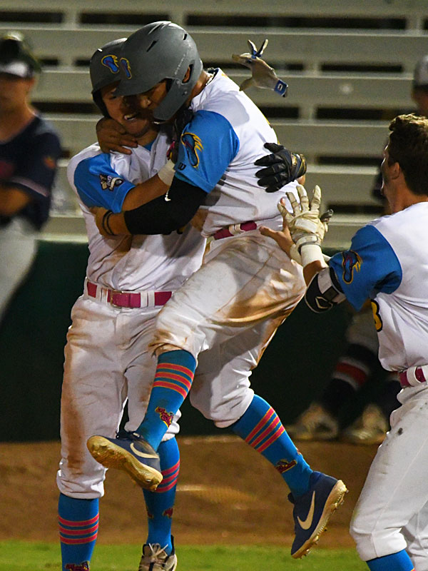 Grant Smith (left) and Johnny Hernandez celebrate after Smith's hit drove in the game-winning run in the bottom of the 12th inning in the Flying Chanclas' 7-6 victory over the Victoria Generals on Saturday at Wolff Stadium. - photo by Joe Alexander