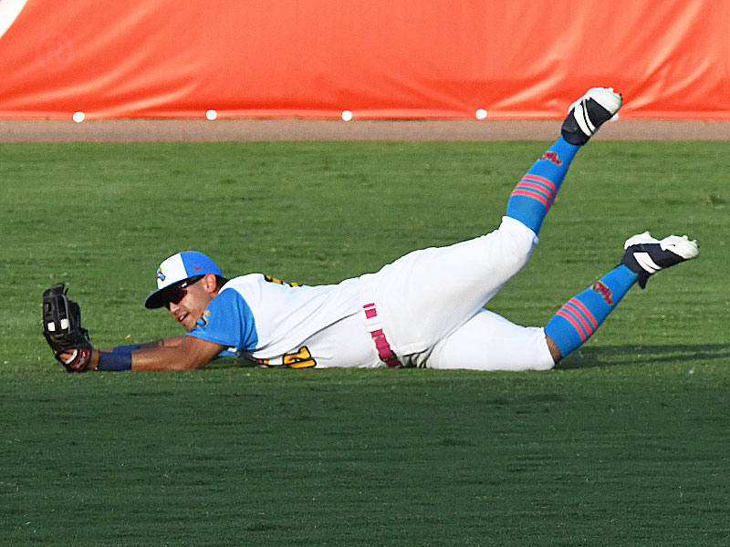 Flying Chanclas left fielder Anthony Forte makes a diving catch on a fly ball that was knocked down by a strong breeze on Thursday against the Brazos Valley Bombers at Wolff Stadium. - photo by Joe Alexander