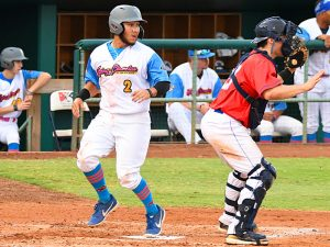 The Flying Chanclas' Johnny Hernandez scores the first run of the game on a double by Battles. - photo by Joe Alexander