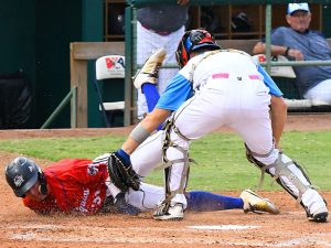 Flying Chanclas catcher Tyler LaRue makes a tag for an out at the plate to complete a triple play in the fourth inning against the Amarillo Sod Squad on Tuesday at Wolff Stadium. - photo by Joe Alexander