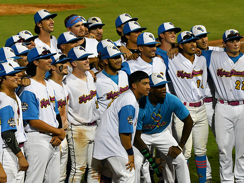 Flying Chanclas players gather for a photo after their game July 29 at Wolff Stadium. - photo by Joe Alexander