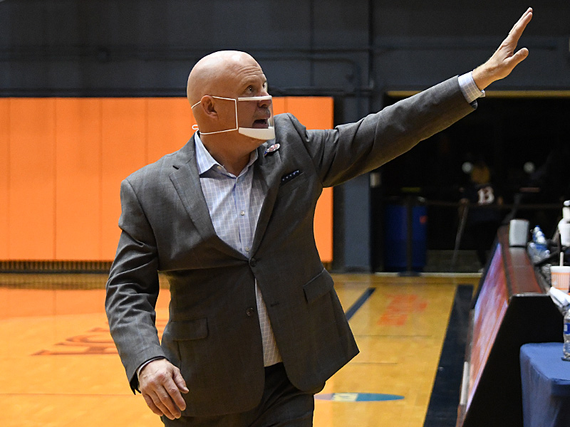 UTSA coach Steve Henson waves to the fans while walking off the court Thursday following the Roadrunners' final home game of the season. - photo by Joe Alexander